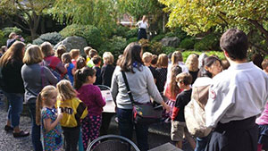 Talking with students about the Nippon Kan gardens-Nippon Kan Vice President Emily Busch