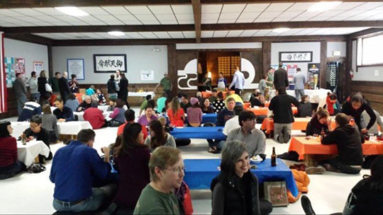 """Bronco fans gather at Nippon Kan dojo for a """"Tailgate Party""""."""