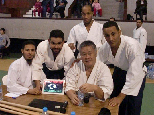Students from Libya showing Homma Kancho a picture of their new national flag.