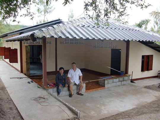 In front of the new Heritage Center; Pastor Bilay and Homma Kancho