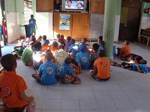 Orphaned boys watching TV at the Yadanapon facility