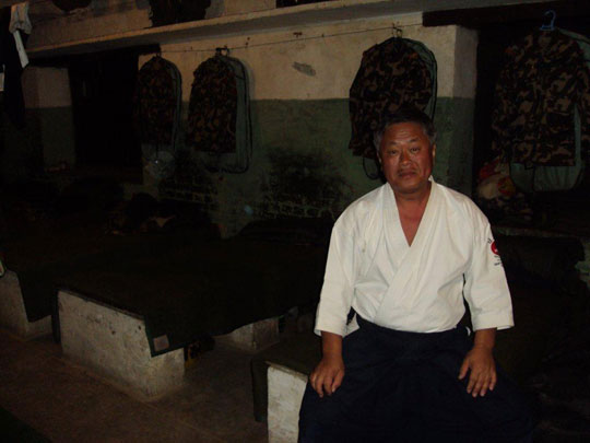Homma Kancho with a tan, rests in the barracks in Nepal.