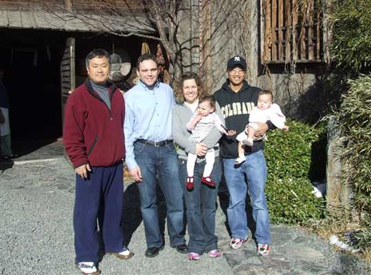 Rob, Class of 98' and current Nippon Kan Instructor Rudy, Class of 97';  Alumni uchideshi with their babies.
