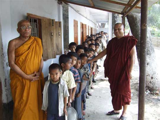 Children lined up waiting for lunch. Right: Ven. Suddhananda Mahathero