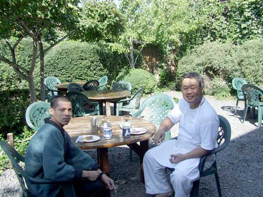 Armando and Homma Kancho sharing a moment in the garden.
