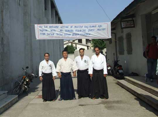 In front of the seminar location. On the right: Ali Sensei  left: Bahram Sensei
