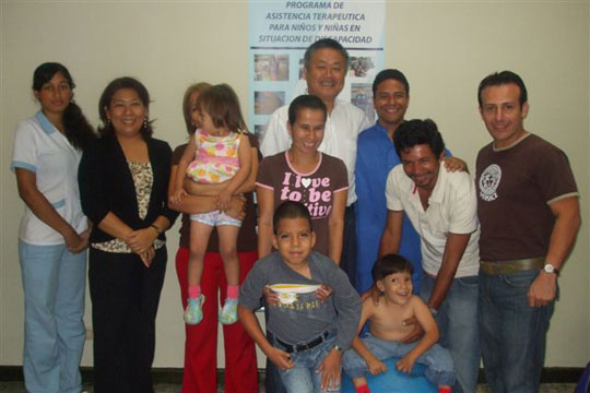 With patients, second from left; Ms. Nakata, far right; Jorge Silva Sensei, center: Homma Kancho, right of center; Mr. Mera.