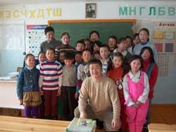 Homma Kancho with children in the first-third grades.