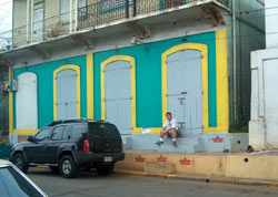 Homma Kancho sits outside of the dojo in Mayaguez reflecting about the pas