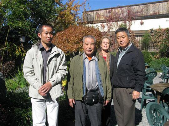 In the Nippon Kan Garden. From left; Shinozaki, Kobayashi Shihan, Homma Kancho.  Second row Emily
