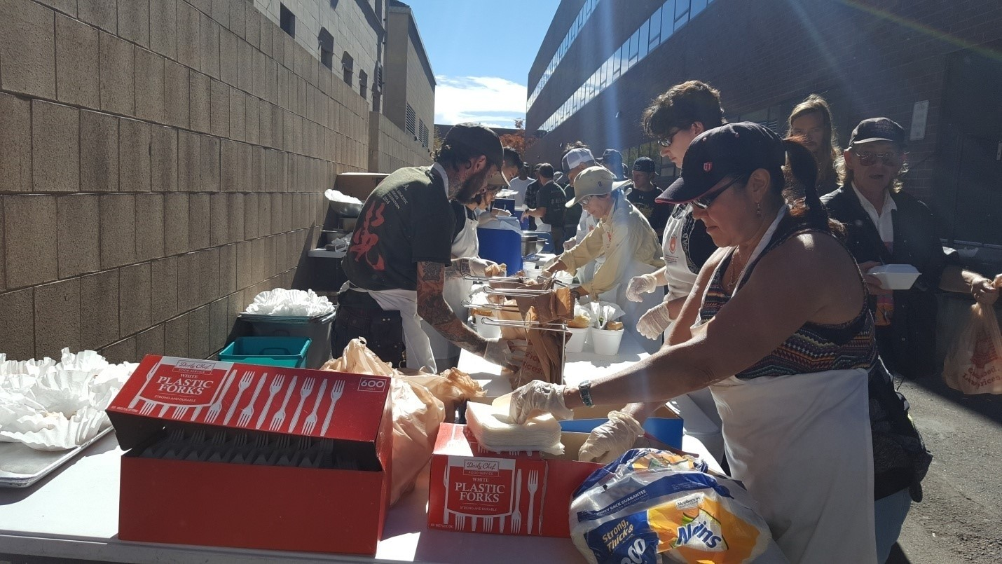 Denver City Councilwoman Debbie Ortega and Nippon Kan volunteer serving meals for those in need in Denver.