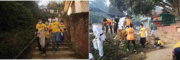 WWY Youth Program Members and Nepal Ranger Instructor volunteers cleaning up a school area in Kathmandu.