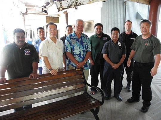 Director General Police Officer (center) Ambassador Kashima (center left)