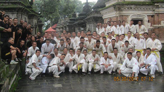 Posing after training in front of a Hindu Temple