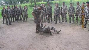 Sgt Gurung teaching soldiers