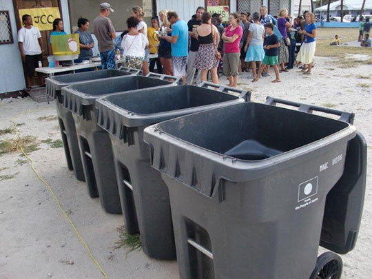 Island trash recycling program with trash containers donated from Japan.