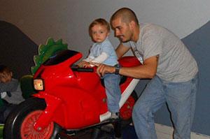 Cihan playing with his son