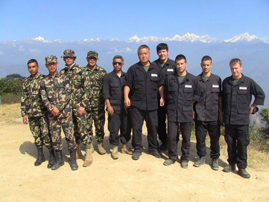 Himalayas n the background. From right: Michele, Domenico, Luca, Koichi, Homma Kancho, Rajesh Bista, Sgt. Gurung