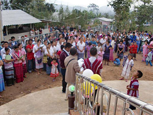 An overflow of people outside the church