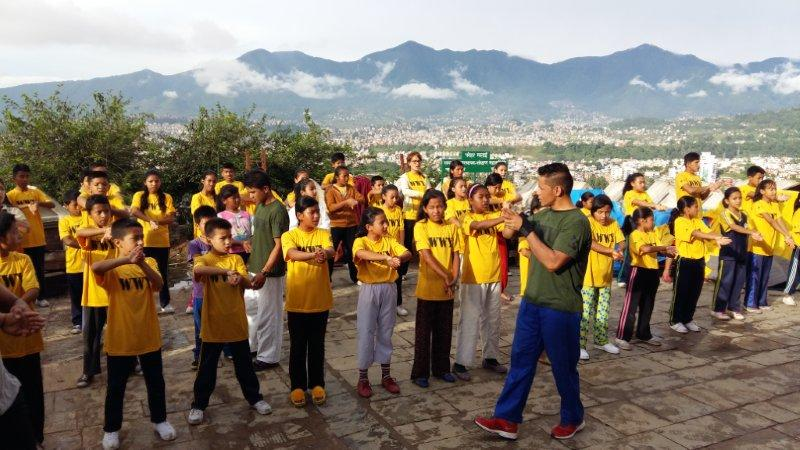 Young refugees singing the Nepal National Anthem at the WWY Project opening ceremony.
