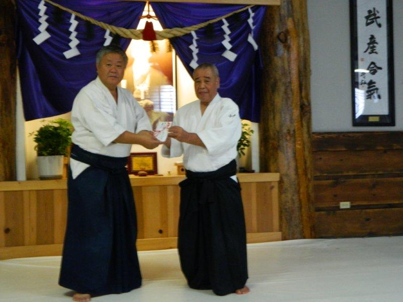 Donation for AHAN Nepal WWY Youth projects received by Gaku Homma Kancho from Kobayashi Soshihan
