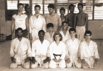 The picture was taken on March, 1994. It was in Santiago de Cuba, in the Judo dojo of the University of Oriente, (formerly Institute of Technology Julio A. Mella) were Susan Kinne taught Aikido. In the picture (names are arranged as they appear in the picture): Top line: Ernesto Robles - Rene Planas - Richard - Mateo - Josmir - ??? - Humberto Planas Middle line: Vladimir Fonseca - ??? Bottom line: Rafael, Redin, Sensei Susan Kinne, Alejandro, Jorge Rivero (myself, also Eitan Behar) I've been trying unsucessfully to find the missing names. Redin and Rene met Susan in her previous trip to Cuba, also in the nineties, and they made the arrangements to open the dojo, and bring students. Except the two missing names, and Humberto, the rest of us were studying engineering in the Institute.